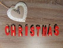 Noël écrit avec la décoration Photographie stock libre de droits