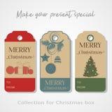 Noël étiquette, des autocollants, des insignes, des labels ou bannière pour votre boîte-cadeau sur le fond gris Illustration de v Photographie stock