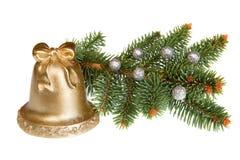 Noël Bell d'or d'isolement avec le pin vert Images libres de droits