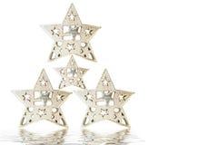 Noël blanc saluant quatre étoiles argentées Image stock