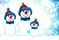 Noël, bonhomme de neige et famille Photos libres de droits