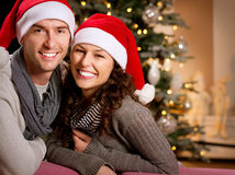Noël. Couples heureux Images libres de droits