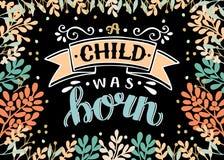 Noël de bible marquant avec des lettres un enfant était né avec des branches sur le fond noir illustration libre de droits