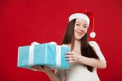 Noël de grossesse sur un fond rouge Image libre de droits
