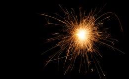 Noël et la nouvelle année font la fête le cierge magique sur le noir Photos stock