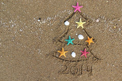 Noël et nouvelle année 2014 sur la plage Image stock