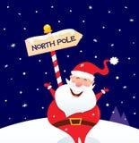 Noël heureux Santa avec le signe de Pôle Nord Image libre de droits