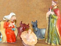 Noël SAINT de famille avec doneky et le boeuf Photographie stock libre de droits