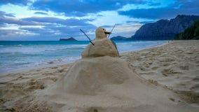 Noël Sandman sur la plage photos stock
