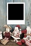 Noël Santa avec un cadre de photo Photographie stock libre de droits
