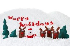 Noël Santa, poupées de cerfs communs en congère, Noël sur le blanc Photographie stock libre de droits