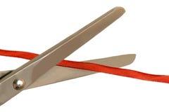 Nożyce cią cienkiego czerwonego faborek Obraz Royalty Free