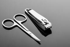 Nożyce i forceps dla dbać dla ręk z odbiciem Obrazy Royalty Free