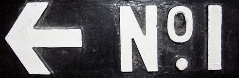 No 1 Arrow. Old painted retro sign noting the location of 'no.1', taken in central London royalty free stock images