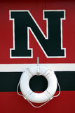 NO!. A red, black and white wall with a life preserver Stock Image