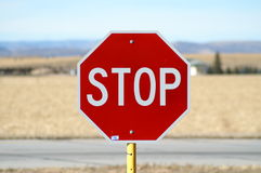 No. A stop sign in the middle of a rural area with no roads royalty free stock photo