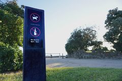 No Alcohol and Dog Must Be On Leash Sign stock image