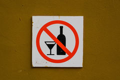 No alcohol sign on wall. Close up no alcohol beverages sign hanging on brown wall royalty free stock images