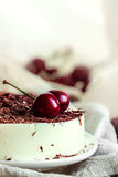 No bake light vanilla bavarois mousse cake with cherries and dark chocolate on top Royalty Free Stock Photography