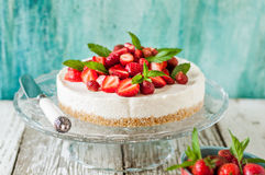 No Bake Strawberry Cheesecake. Decorated with Fresh Berries and Mint, square stock photography