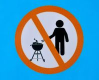 No barbecuing here sign on a blue background royalty free illustration