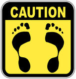 No bare feet sign. Yellow and black caution sign with foot print - no bare feet Stock Photography