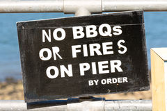 No BBQs or Fires on the Pier - by order sign Stock Image