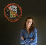 No beer alcohol woman smiling glasses on blackboard background Stock Image