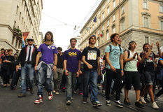 No Berlusconi Day 2. Young demonstrators of the People in Purple (Popolo Viola) march during the 2nd No Berlusconi Day against the prime minister Silvio Stock Photo