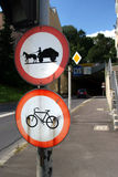 No bicycle and coach signs. Signs (no bicycle, no coach) on a traffic light before a tunnel. Taken in Linz, Austria. The signs were additional flashed Royalty Free Stock Photography