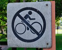No bike riding sign. In a garden Stock Photography