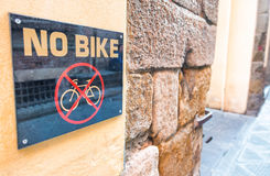 No bike sign along city street Stock Photography