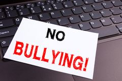 No Bullying writing text made in the office close-up on laptop computer keyboard. Business concept for Bullies Prevention Against Stock Images
