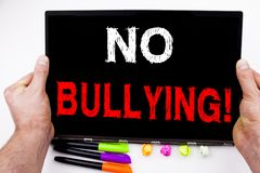 No Bullying text written on tablet, computer in the office with marker, pen, stationery. Business concept for Bullies Prevention A Stock Image