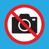 No cameras allowed sign. Red prohibition no camera sign. No taking pictures, no photographs sign. Vector illustration isolated on blue background royalty free illustration