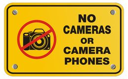 No cameras or camera phones yellow sign - rectangle sign Royalty Free Stock Image