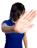 No cameras please. Camera shy asian girl does not want to be photographed Stock Image