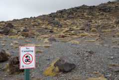 No Camping sign in mountains. No Camping sign on the way of Tongariro Alpine Crossing, New Zealand Stock Photo