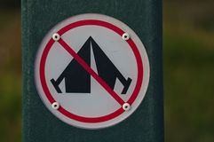 No camping sign. In white black and red colors in rounded shape display stock image
