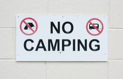 No camping. Sign on a white brick wall royalty free stock photography