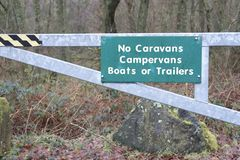 No caravans camper vans boats or trailers sign at holiday park in countryside. Loch Lomond Scotland Stock Photos