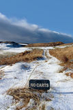 No carts sign on a snow covered links golf course Royalty Free Stock Photos