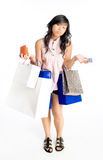 No Cash No Credit. Teenager girl laden with shopping bags, running out of cash and credit limits, after a shopping spree Stock Photography