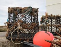 No Catch Today. Empty lobster pots and buoy on the quayside Royalty Free Stock Images