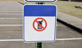 No Cell Phones. A sign warns that cell phones are prohibited in this area Stock Photo
