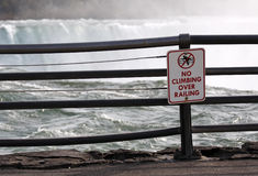 No climbing over railing!. Warning sign at Niagara Falls. Good idea stock images