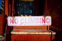 No climbing sign hanging by rusty wire Stock Images