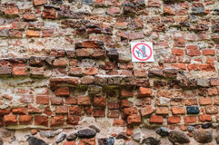 No climbing sign on old insecure wall. Caution symbol Stock Photography