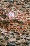 No climbing warning sign on ancient wall Stock Photo