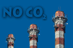 No CO2. Text on the blue sky above industrial chimneys Stock Photos